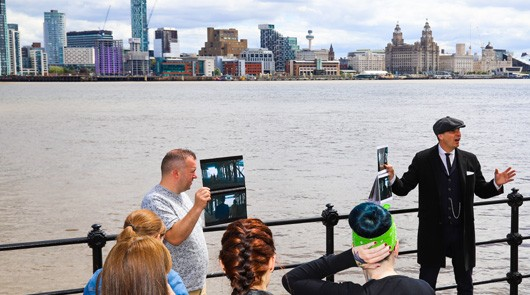 Peaky Blinders Tour Liverpool - Guide with Liverpool behind him